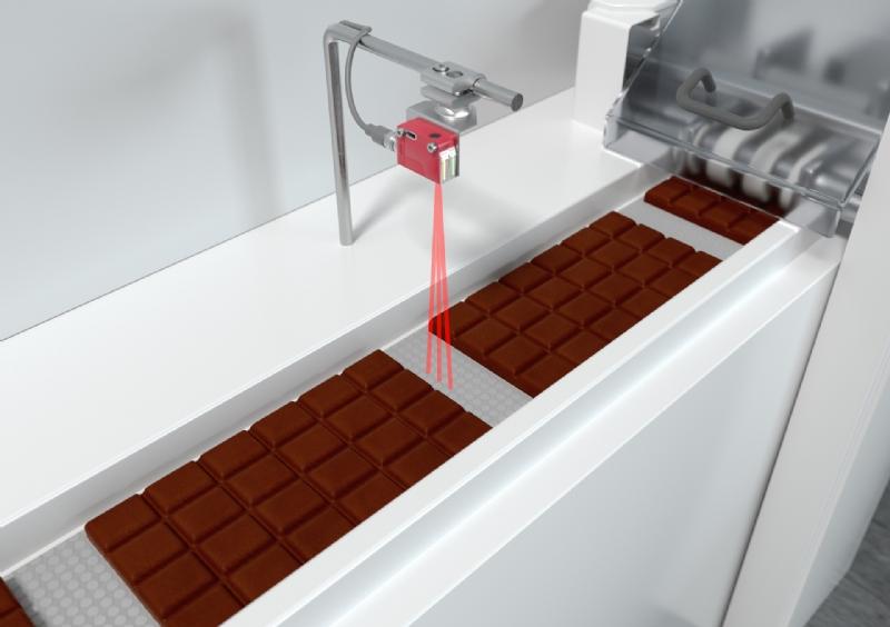 Nuova Fotocellula a tasteggio di primo piano con riferimento dinamico dello sfondo per applicazioni nel settore del packaging.
